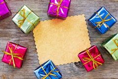 Christmas card with a colorful gifts Stock Photography