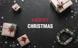 Christmas card. With a congratulatory message for loved ones. Gifts that are waiting for children. The Xmas ambience is. Christmas card. With a congratulatory Royalty Free Stock Photo