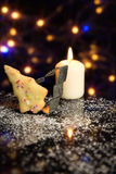 Christmas card with Cookie, Cookie cutter and a candle in front Stock Photo