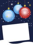 Christmas card with copy space. Dark blue christmas card with copy space for writing and blue and red glass balls Royalty Free Stock Images