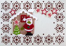Christmas Card with Copy Space, Decoration made of Santa with Tree and Stars in little house stock photography