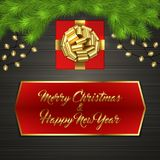 Christmas tree, gift box, bow, garland, label. Christmas card with Cristmas fir tree branches, red square gift box with gold ribbon bow, garland on black wooden Royalty Free Stock Photos
