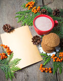 Christmas card with cup of cocoa, fir tree, pinecones and rowan Stock Photos