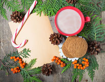 Christmas card with cup of cocoa, fir tree, pinecones and rowan Royalty Free Stock Images