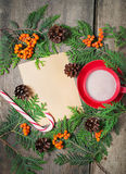 Christmas card with cup of cocoa, fir tree, pinecones and rowan Stock Photography