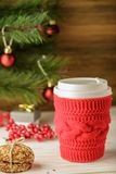 Christmas card. Cup of coffee on Christmas background. The warm Stock Photos
