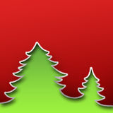 Christmas card. Cut paper design. Green trees on red. Royalty Free Stock Images