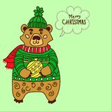 Christmas Card with Cute Bear in sweater with christmas ball royalty free stock image