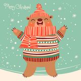 Christmas card with a cute brown bear. Stock Photos