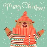 Christmas card with a cute brown bear. Stock Photography