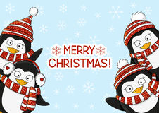 Christmas card with cute cartoon penguins Royalty Free Stock Photo