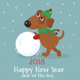 Christmas card with cute dog in hat and scarf with snowball. Christmas card with a cute cartoon dog in hat and scarf with snowball on blue background with snow Royalty Free Stock Image