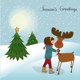 Christmas card with cute little girl caress a rein Royalty Free Stock Image