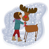 Christmas card with cute little girl caress a rein Royalty Free Stock Photography