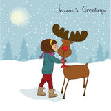 Christmas card with cute little girl caress a rein Royalty Free Stock Photos