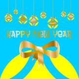 Christmas card decorated with colored balls and golden bow and `Happy new year` written in Spanish language, on blue background. Christmas card decorated with Stock Images