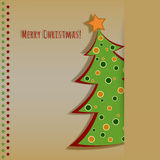 Christmas card with decorated fir tree. On the yellow background Royalty Free Stock Photography