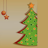 Christmas card with decorated fir tree. On the yellow background Stock Photography