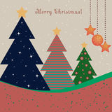 Christmas card with decorated fir trees Stock Image
