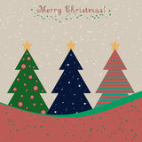 Christmas card with decorated fir trees. And snowfall Stock Photo