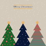 Christmas card with decorated fir trees Royalty Free Stock Image