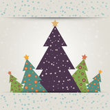 Christmas card with decorated fir trees. And snowfall Royalty Free Stock Photos