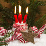 Christmas card decorated with four red burning candles Stock Image
