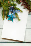 Christmas card with decoration with copy space. Christmas card with decoration on a wooden board with copy space Royalty Free Stock Photography