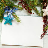 Christmas card with decoration with copy space. Christmas card with decoration on a wooden board with copy space Stock Images