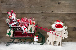 Christmas Card Decoration: Elks Pulling Santa Sleigh With Gifts Royalty Free Stock Image