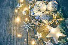 Christmas card with decoration glass balls garland on old wooden board in rustic style copyspace. Stock photo Royalty Free Stock Images