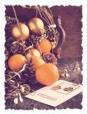 Christmas Card with decoration, oranges and pine cones Stock Photography