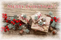 Christmas card. Decoration with presents on wooden background Royalty Free Stock Photo