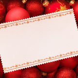 Christmas card with decoration. On red background Royalty Free Stock Image