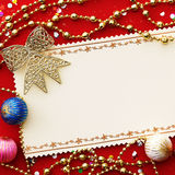 Christmas card with decoration. On red background Stock Images