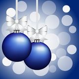 Christmas card with Christmas decorations. Christmas card with balls and bows on a blue background Stock Image