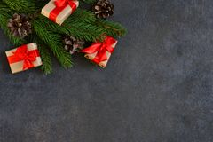Christmas card with decorations from a Christmas tree with gifts stock images