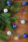 Christmas Card with decorations - silver thread, scissors, xmas tree and color balls. Royalty Free Stock Photos