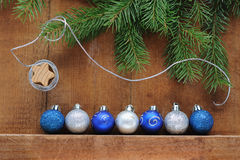 Christmas Card with decorations - silver thread, xmas tree and color balls. royalty free stock images