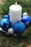 Christmas Card with decorations - white candle, xmas tree and color balls. Stock Photography