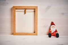 Christmas decorations on a wooden table with blank frame. Christmas card with decorations on a wooden table with blank frame stock images