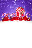Christmas card with decorative baubles and candies Royalty Free Stock Photography