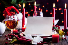Christmas card in dishware at the table Royalty Free Stock Images