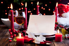 Christmas card in dishware at the table Stock Photo