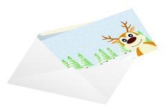 Christmas card in an envelope. Stock Photos