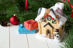 Christmas card with fairy house, gifts and pine branch. Stock Image