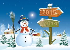Christmas card with a festive Christmas tree and s. Nowman on the background of a winter landscape Royalty Free Stock Image