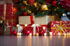 Christmas card with festive decorations, gifts and lights over colorful background copyspace.  Stock Photography