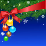 Christmas card. Card with fir and Christmas balls on blue background Royalty Free Stock Photography