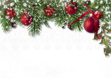 Christmas card with fir branches, balls and holly on a white background
